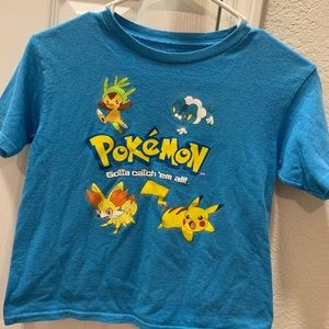 Blue Pokémon T-shirt with characters.